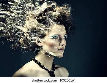 Beautiful woman with gold foliage and curly hair