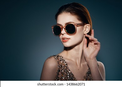 18fb86086722 Beautiful woman golden dress dark glasses charm model studio smile