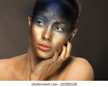 Beautiful woman with golden face