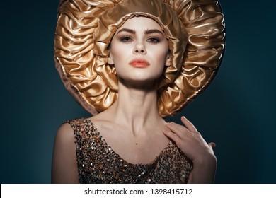 beautiful woman in golden headdress model appearance elegant look phone lifestyle