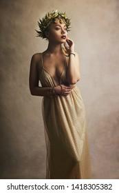 beautiful woman in greek greece goddes dress and wreath high fashion