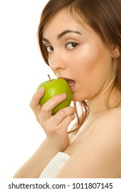 Beautiful woman with green apple isolated on white