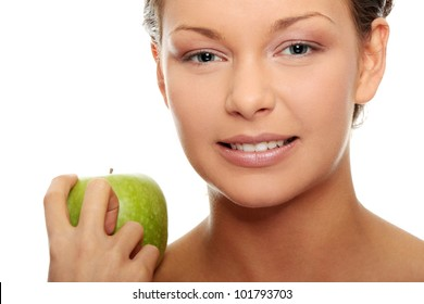 Beautiful woman with green apple isolated on white background