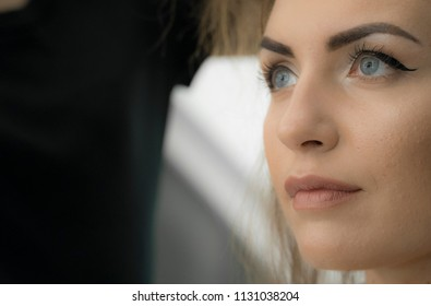 Beautiful woman with green eyes and professional makeup