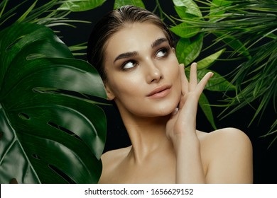 Beautiful woman green leaves charm naked shoulders island spa treatments