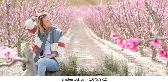 Beautiful woman in a grove of fruit trees in Cieza in the Murcia region. Peach, plum and nectarine trees. Spain