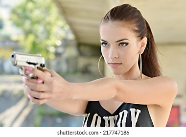 Beautiful woman with gun