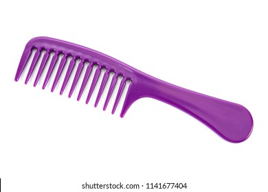 Beautiful woman hair comb isolated on white background.Purple hairbrush isolated