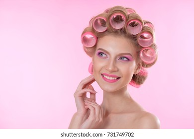 Beautiful  woman with hair curlers