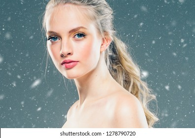 Beautiful woman with beautiful hair and makeup winter background snow