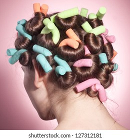 Beautiful woman with hair rollers