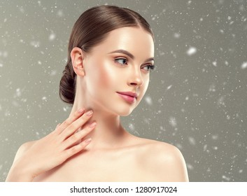 Beautiful woman hair and skin beauty winter background snowflakes