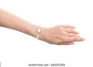 Beautiful woman hand wearing jewelry bracelet with nacre and pearls isolated on white background