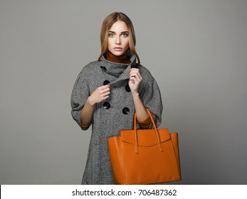 beautiful Woman with Handbag.Fashion Girl in topcoat.Shopping lady