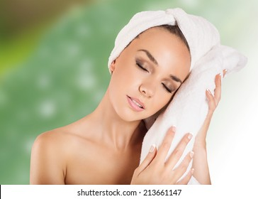 beautiful woman handle towel in spa salon, after bath, isolated on green background with flowers