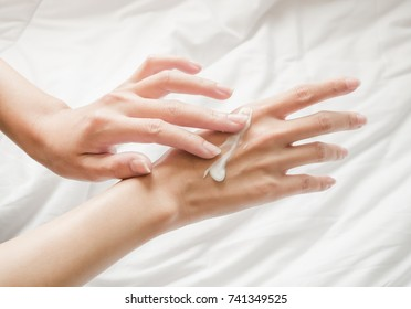 Beautiful woman hands with cream