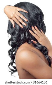 Beautiful woman with hands on her curly hair, back view, isolated on white, Healthy hair and nails concept