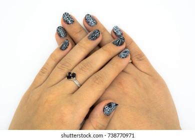 Beautiful woman hands wearing blue varnish card