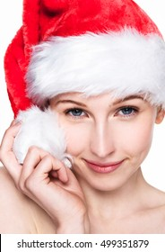 Beautiful woman happy christmas in santa hat on white background