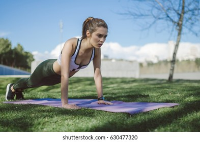 beautiful woman happy doing exercise and working out , abs outdoor
