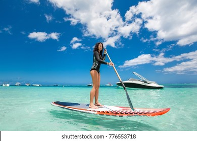 Beautiful woman has surfing in a beautiful sunny day