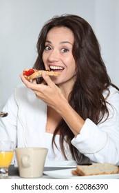Beautiful woman having breakfast at home
