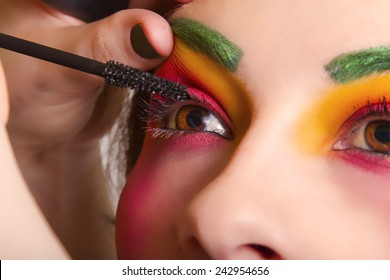 Beautiful Woman Having Colorful Makeup Put On Her Face