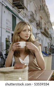 Beautiful woman having a cup of cappuccino