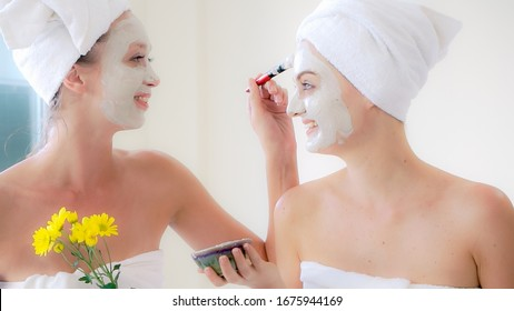 Beautiful woman having a facial cosmetic scrub treatment at wellness spa. Anti-aging, facial skin care and luxury lifestyle concept.
