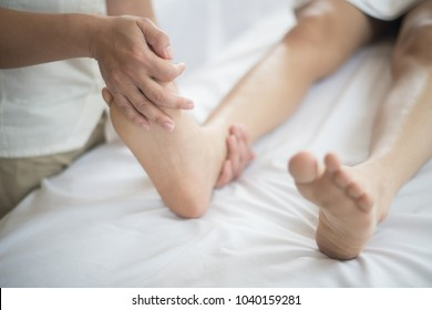 Beautiful woman having feet massage in beauty salon, relax and healthy.