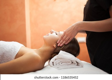 Beautiful woman having an head massage