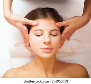 Beautiful woman having an head massage
