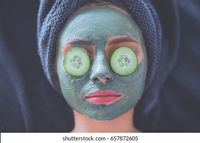 Beautiful woman having mask , lying on spa