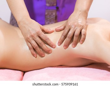 Beautiful woman having a wellness back massage and feeling visibly good about it