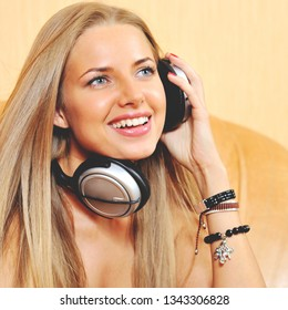 Beautiful woman with headphones listening to the music