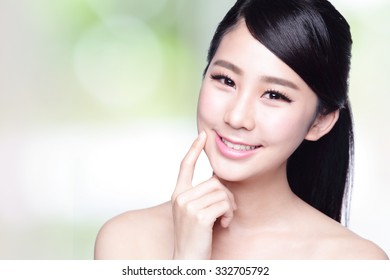 beautiful woman with health teeth smile to you with nature green background. asian Beauty