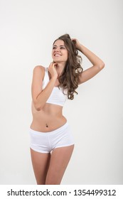 Beautiful woman with healthy body on white background
