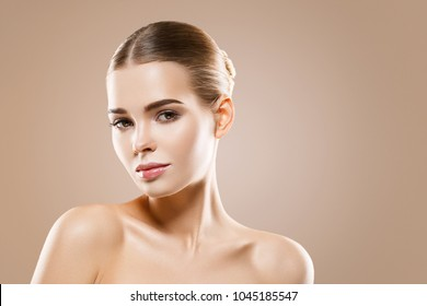 Beautiful woman healthy skin care concept portrait close up on beige background