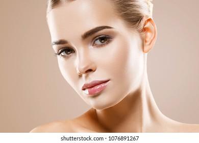 Beautiful woman healthy skin care concept portrait close up on beige background. Studio shot.