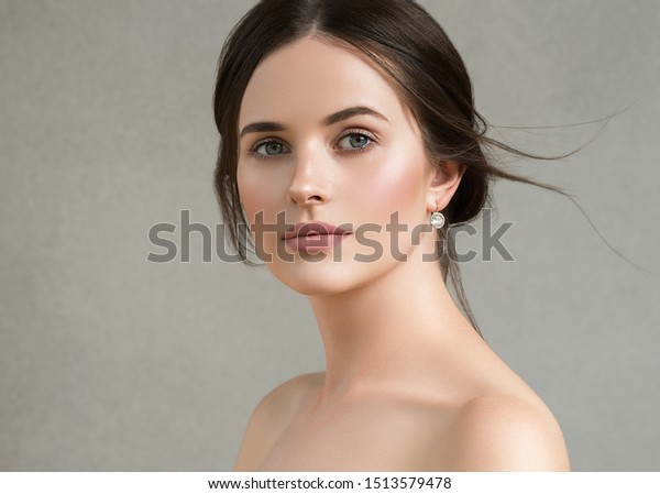 Beautiful woman healthy skin over garay background