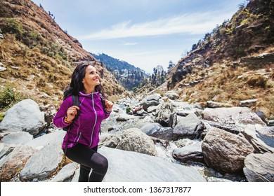 Beautiful woman in her 40s trekking alone in Indian Himalayas