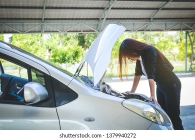 Beautiful woman, her car is broken While she was rushing to work at the office