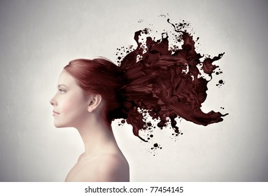 Beautiful woman with her hair melting in brown paint