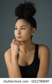 Beautiful Woman with Her Hair Up and Natural Look Cosmetics
