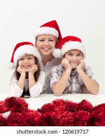 Beautiful woman with her kids at christmas time