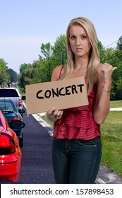 Beautiful woman hitch hiking to a concert