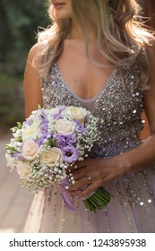 beautiful woman holding a bouquet of flowers