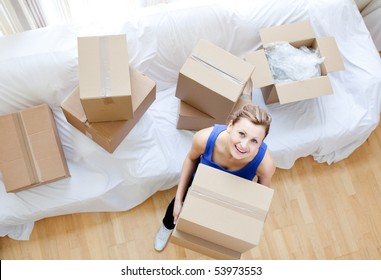 Beautiful woman holding a box at home