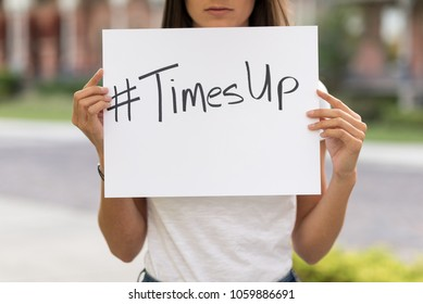 Beautiful Woman Holding a Card with #Timesup written on it