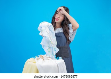A beautiful woman holding a cloth prepared to wash on a blue background.